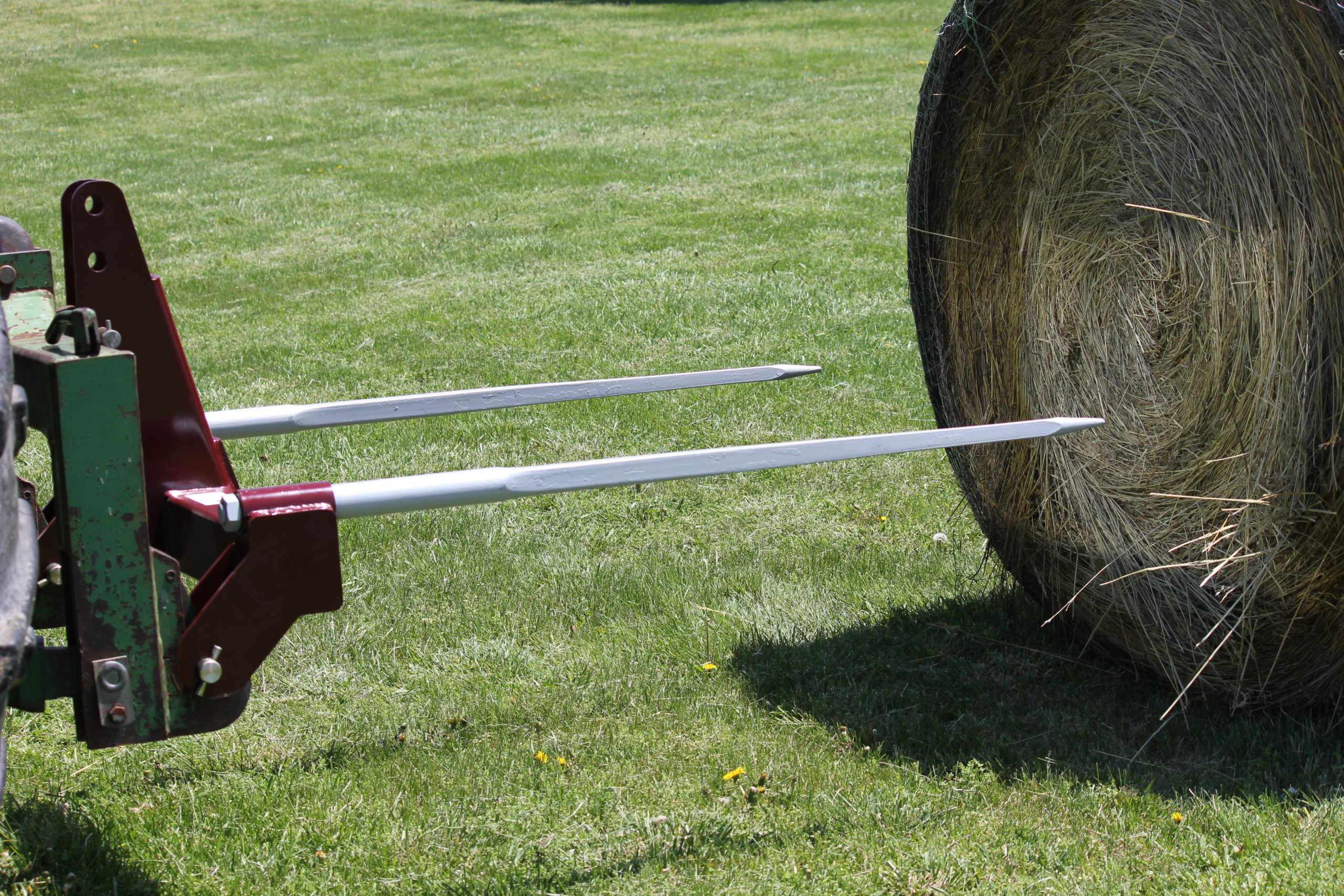 3-Point Double Quick-Hitch hay bale spear beginning to pierce a big bale