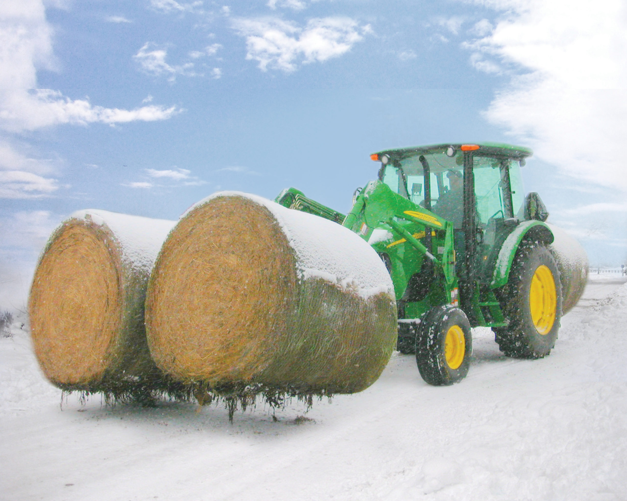 John Deere Two Bale Mover lifting two bales