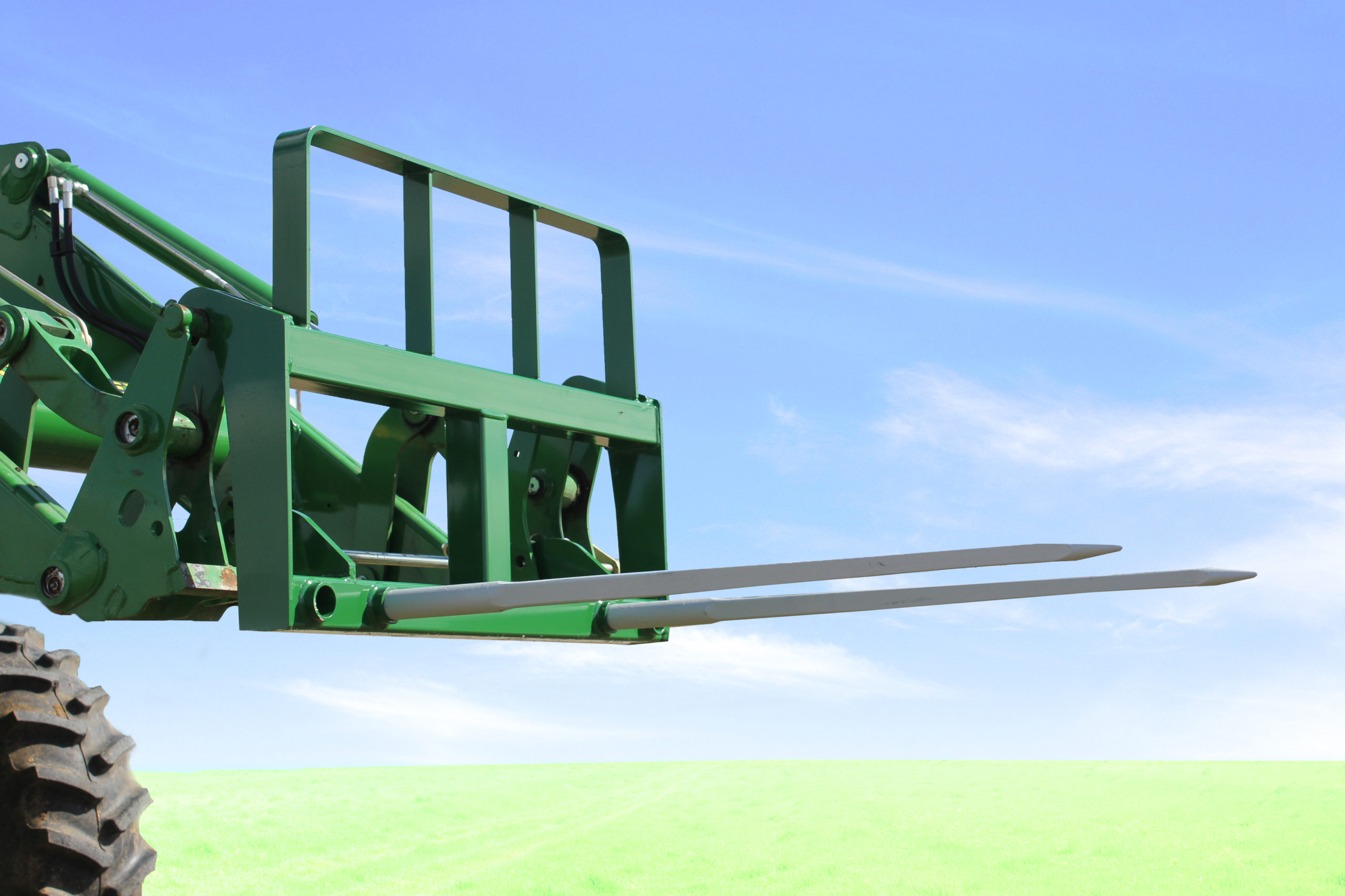 green WorldWide Double Front Loader hay bale spear